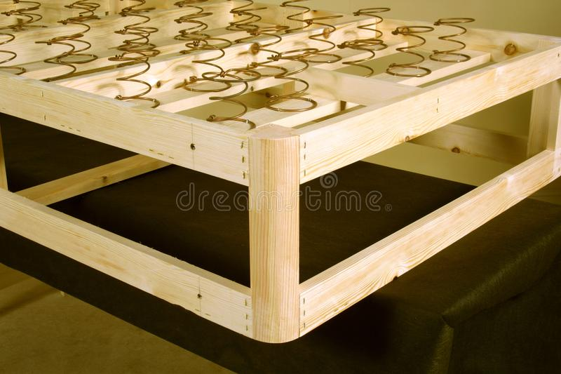 Bed. Stage in the manufacture of a traditional hand-made bed frame royalty free stock image