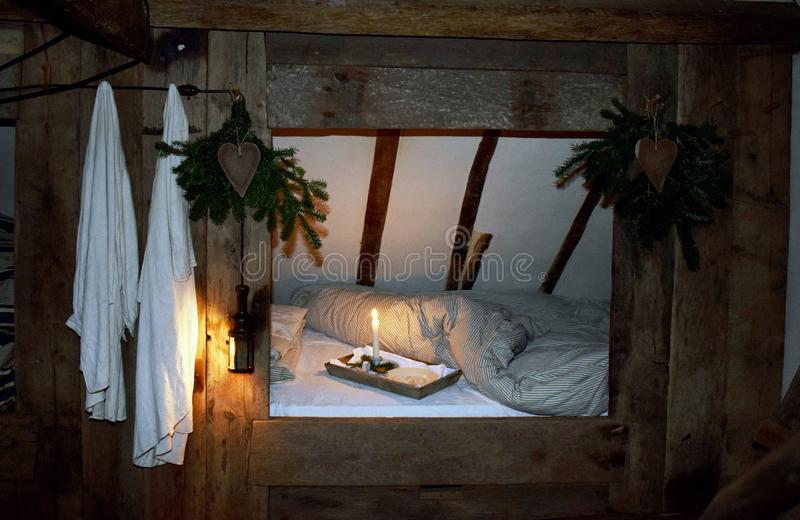 A old fashion bed in a Tudor period house. A bed in a Tudor period house, the bed has a wooden frame around it that goes from the floor to the ceiling so it stock images
