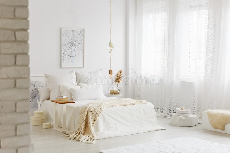 Bed with white bedding stock photo