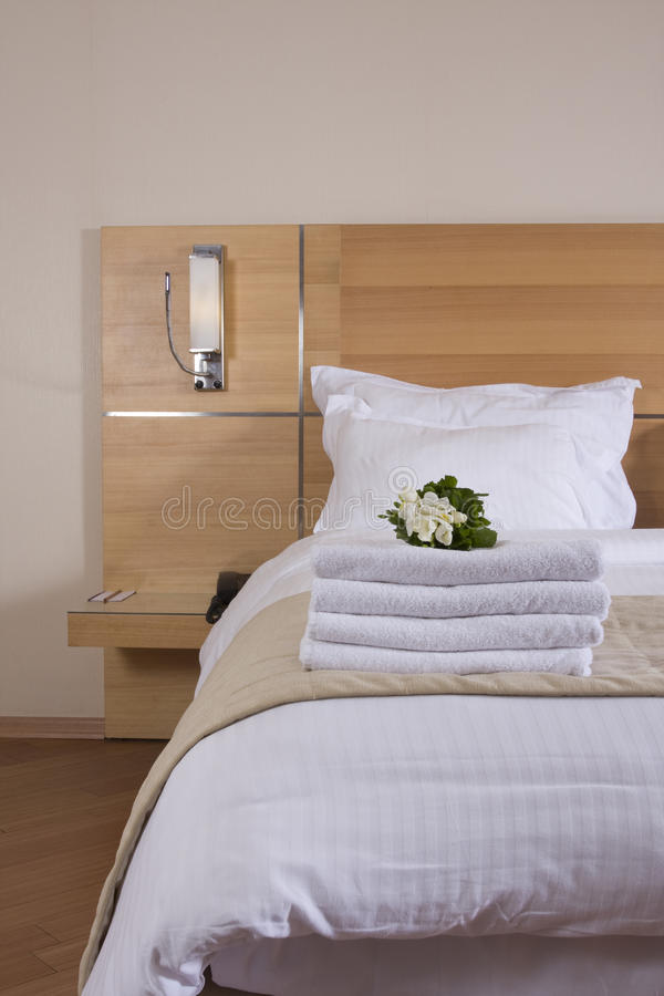 Bed with white flowers royalty free stock images