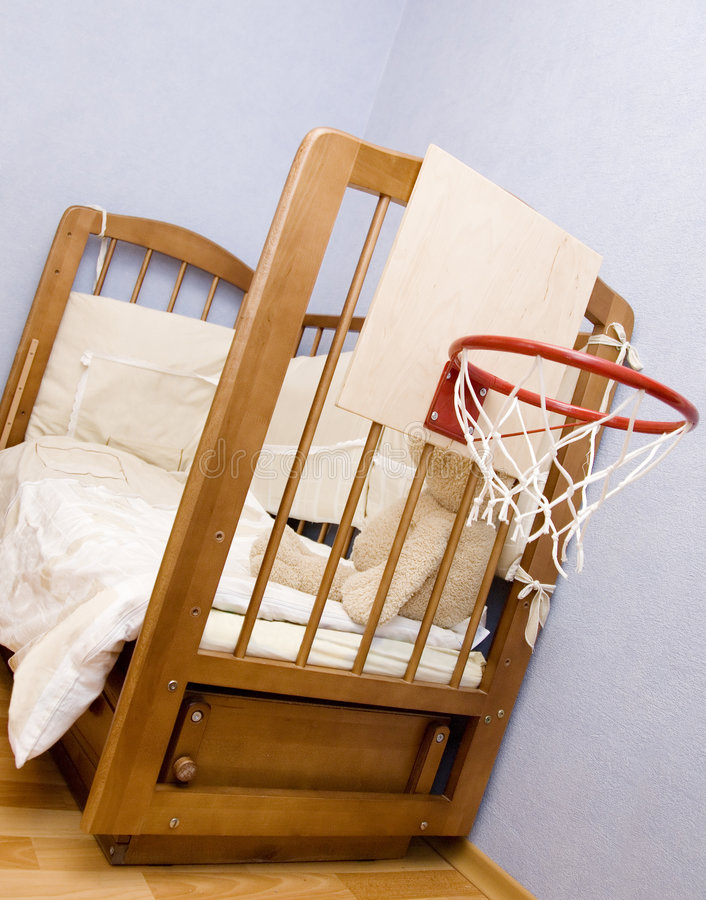 Bed of youth basketball-player. Basketbal ring on the kid's bed stock photo