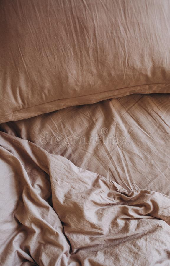 Bedding items bed beige pillow blanket textiles stock photography