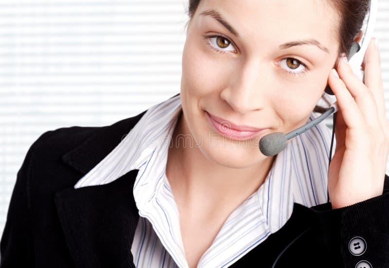 Bediener mit Kopfhörer stockbild