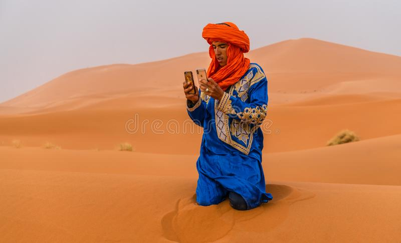 Bedouin man take a picture stock photo
