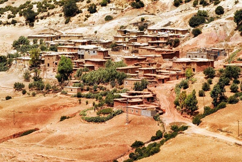 Bedouin village in Atlas mountains, Sahara, Morocco. Red clay stone bedouin village in Atlas mountains, Sahara, Morocco royalty free stock image