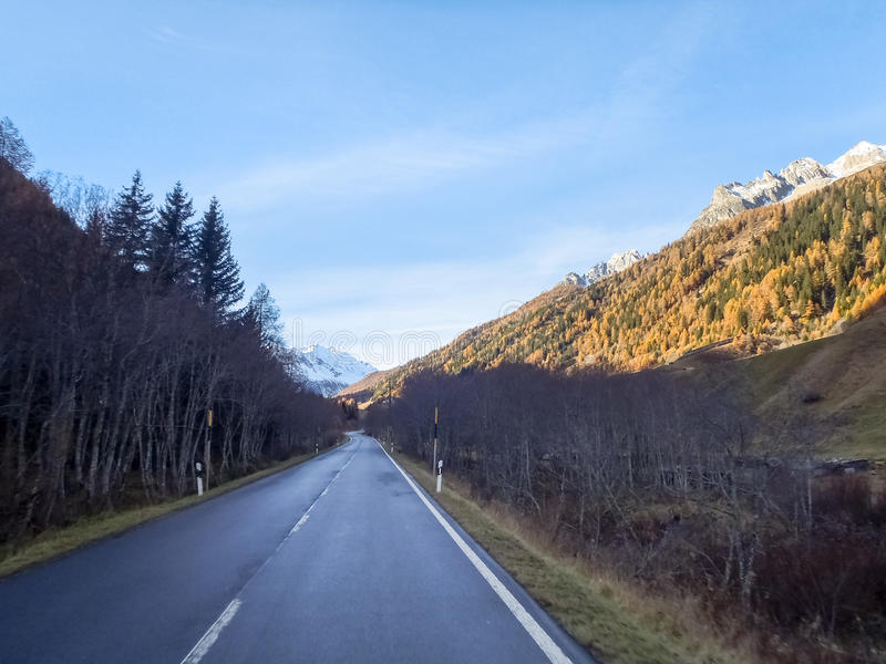 Bedretto Valley and the Nufenen pass. Nufenenpass, Switzerland: Bedretto Valley and the Nufenen pass with residual snow royalty free stock image