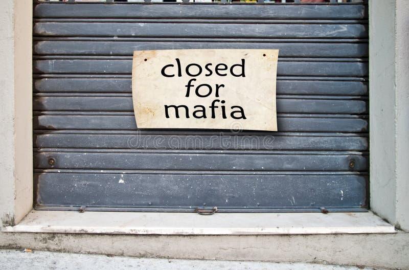 Bedrijf gesloten die winkel wegens de Maffia wordt gesloten stock afbeelding