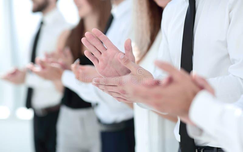 Bedrijfs achtergrond bedrijfscollega'sstaande ovatie stock fotografie
