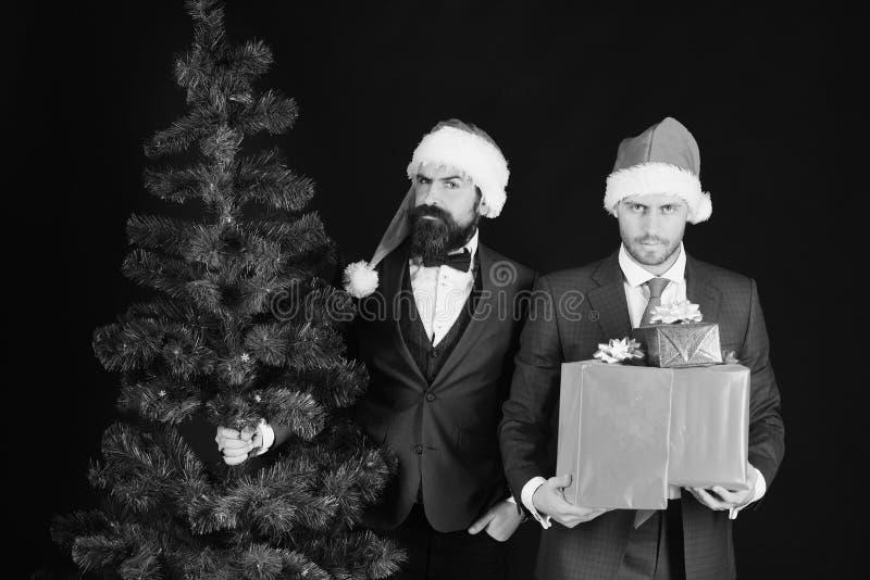 Bedrijfs en de wintervakantieconcept Zakenlieden met strikte gezichten stock foto