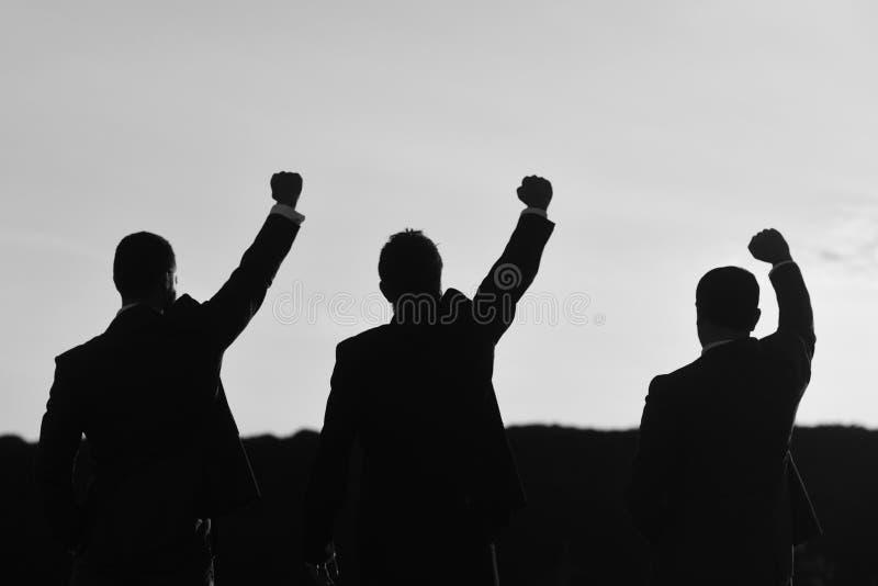 Bedrijfs en succesconcept De leiders bespreken omhoog, de handen van de projectgreep royalty-vrije stock foto