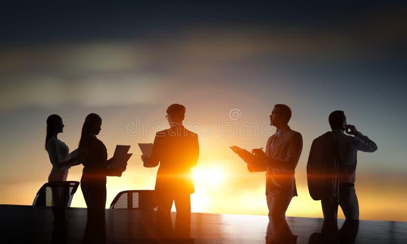 Bedrijfs groepswerkconcept Gemengde media royalty-vrije stock afbeelding