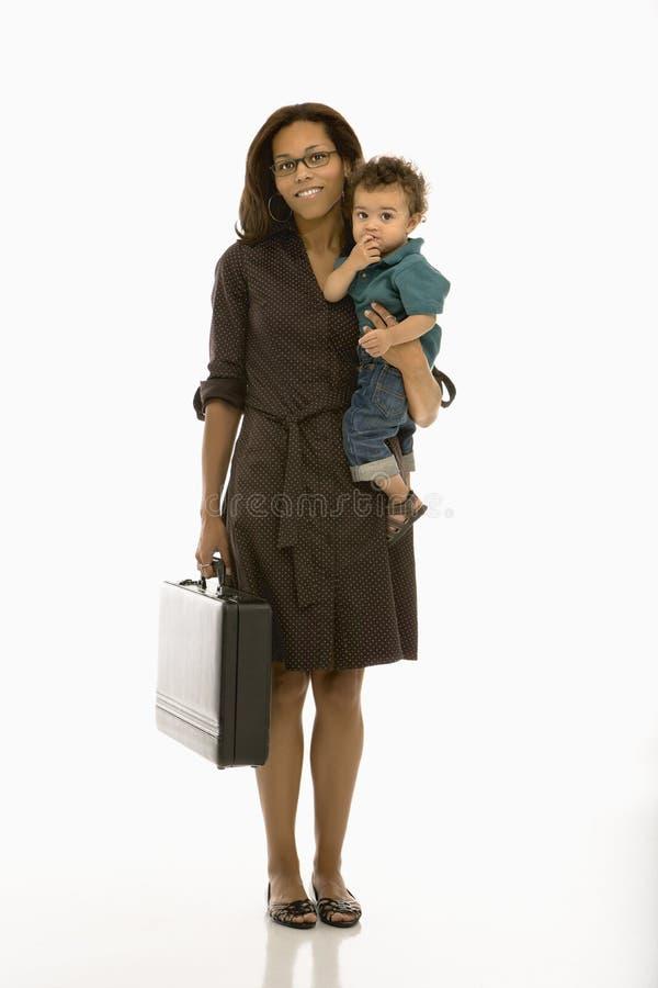 Bedrijfs mamma met kind. royalty-vrije stock afbeelding