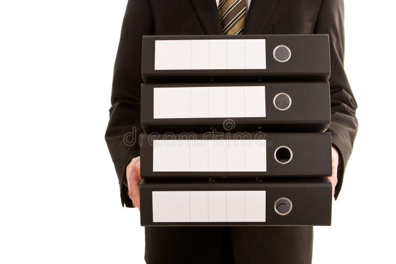 Bedrijfs mens die drie omslagen houdt royalty-vrije stock foto