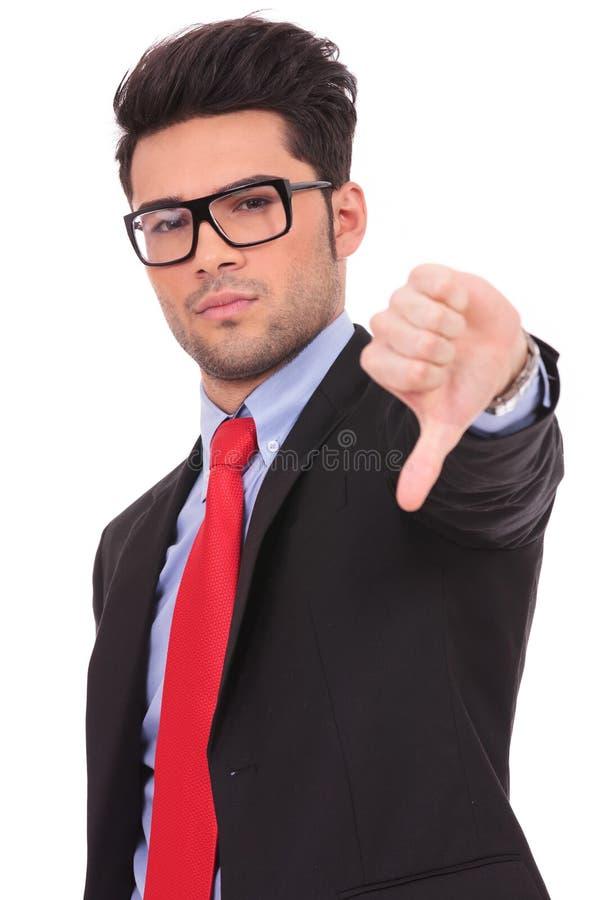 Bedrijfs mens die duim neer tonen stock foto's