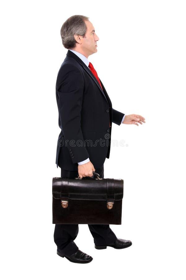 Bedrijfs mens die met een aktentas loopt stock afbeeldingen