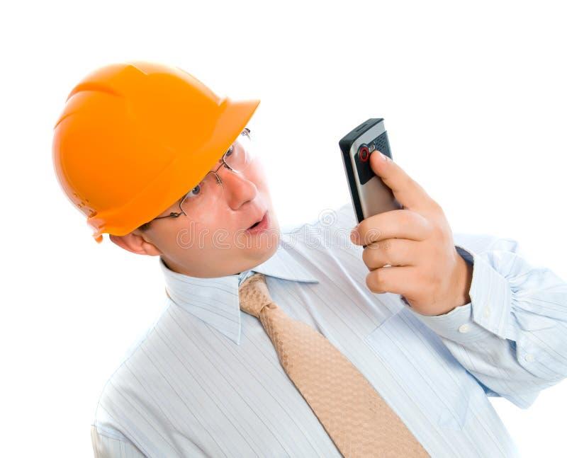 Bedrijfs mens die mobiele telefoon met behulp van stock fotografie