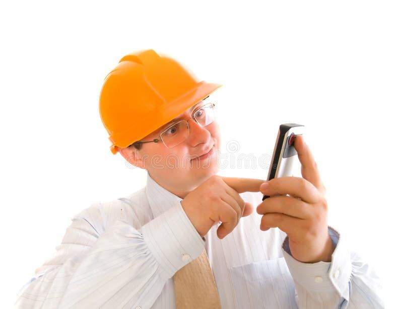 Bedrijfs mens die mobiele telefoon met behulp van stock foto's