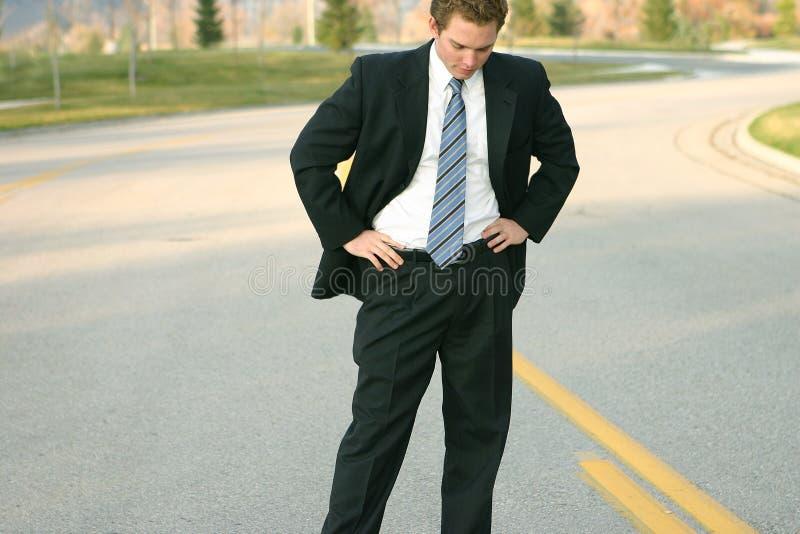 Download Bedrijfs Mens Die Neer Kijkt Stock Foto - Afbeelding bestaande uit businessperson, zonnig: 41640
