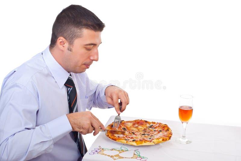 Bedrijfs mens die pizza eet royalty-vrije stock afbeeldingen
