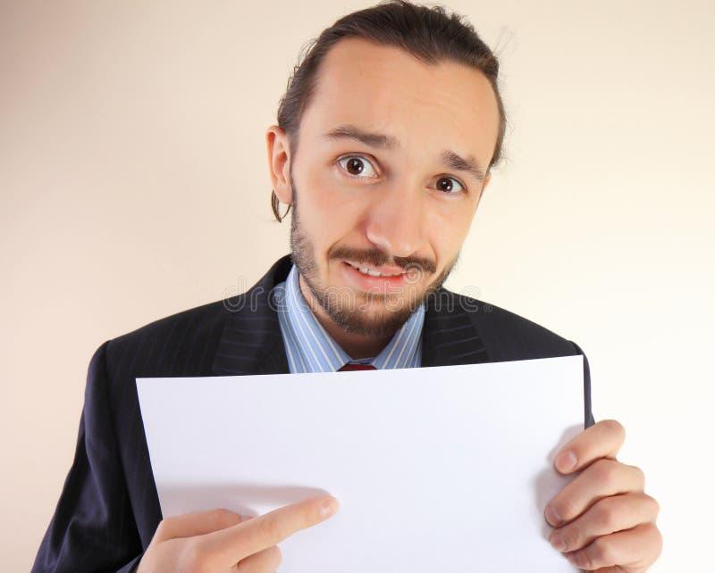 Bedrijfs mens met een lege witte kaart. royalty-vrije stock foto