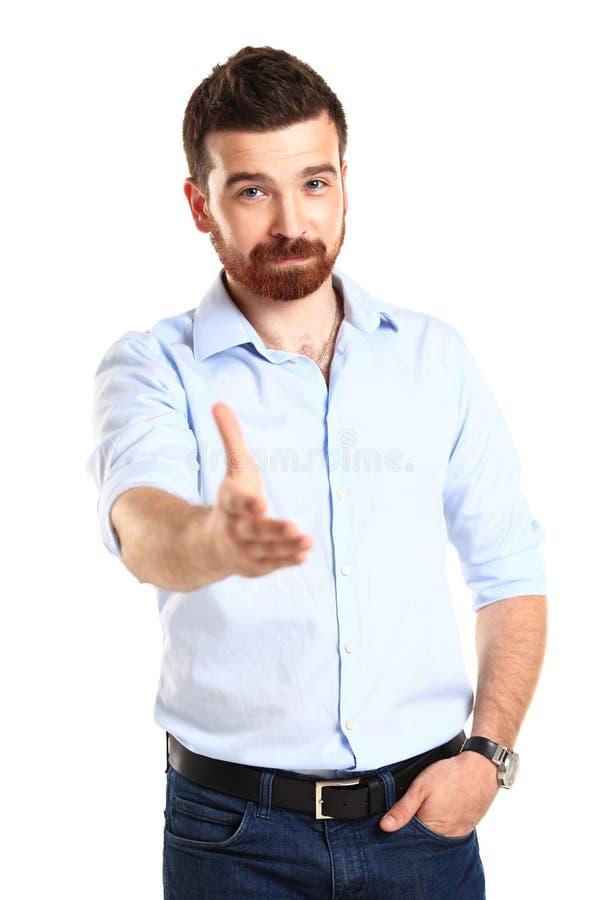 Bedrijfs mens met een open hand klaar om een overeenkomst te verzegelen royalty-vrije stock afbeelding
