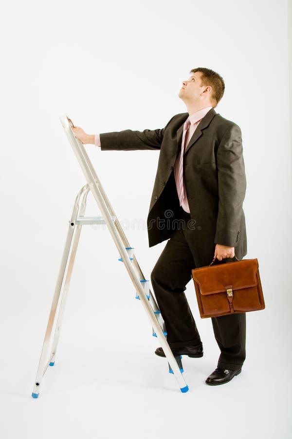Bedrijfs mens met ladder stock foto's