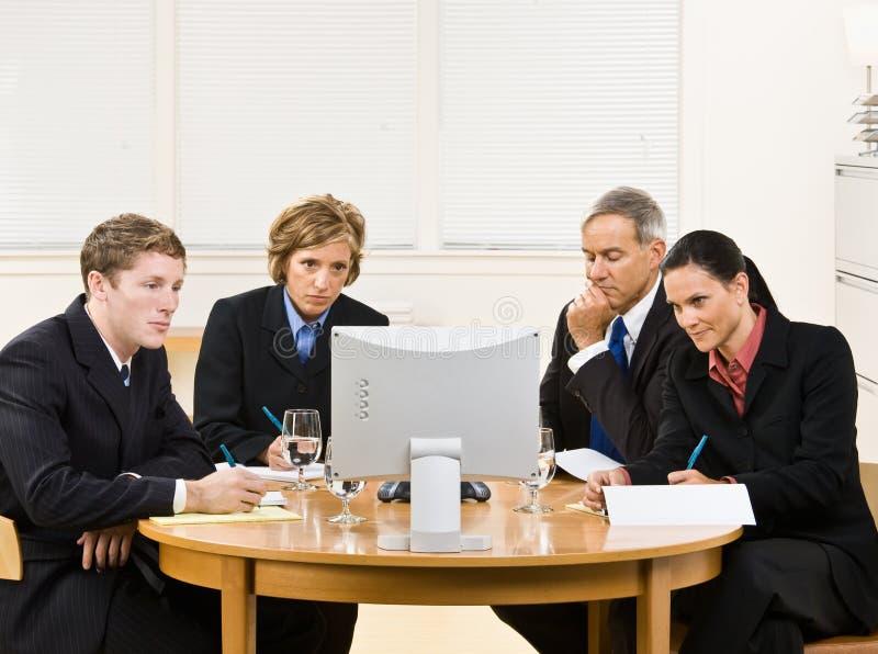 Bedrijfs mensen in videovergadering royalty-vrije stock afbeelding