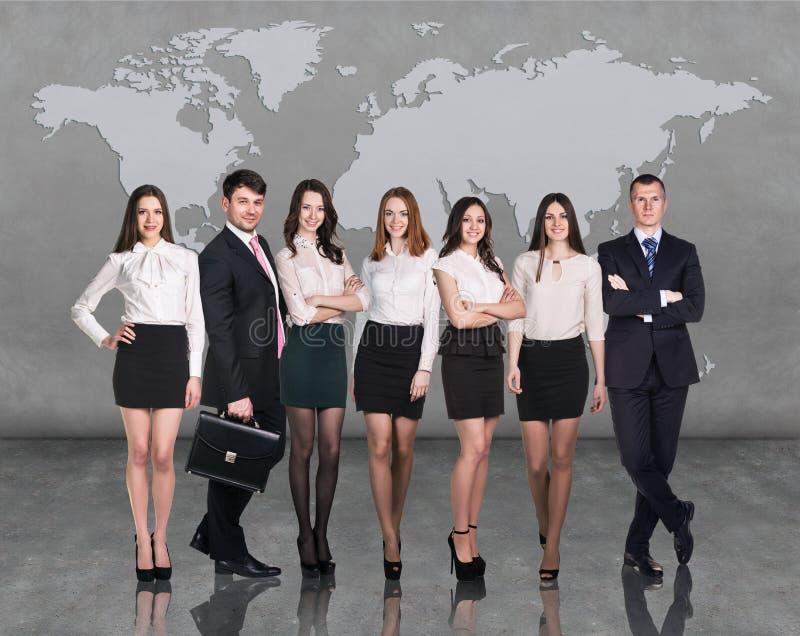 Bedrijfs mensenteam met wereldkaart stock fotografie