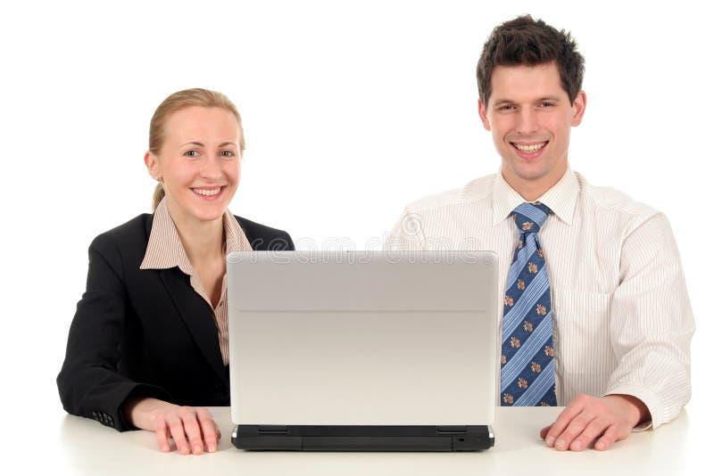 Bedrijfs paar met laptop royalty-vrije stock foto