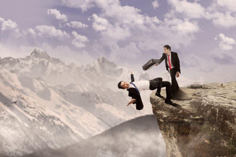 Bedrijfs slag bovenop klip stock foto's