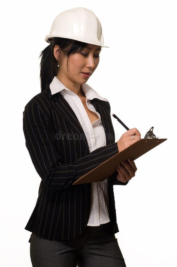 Bedrijfs vrouw in bouwvakker stock foto