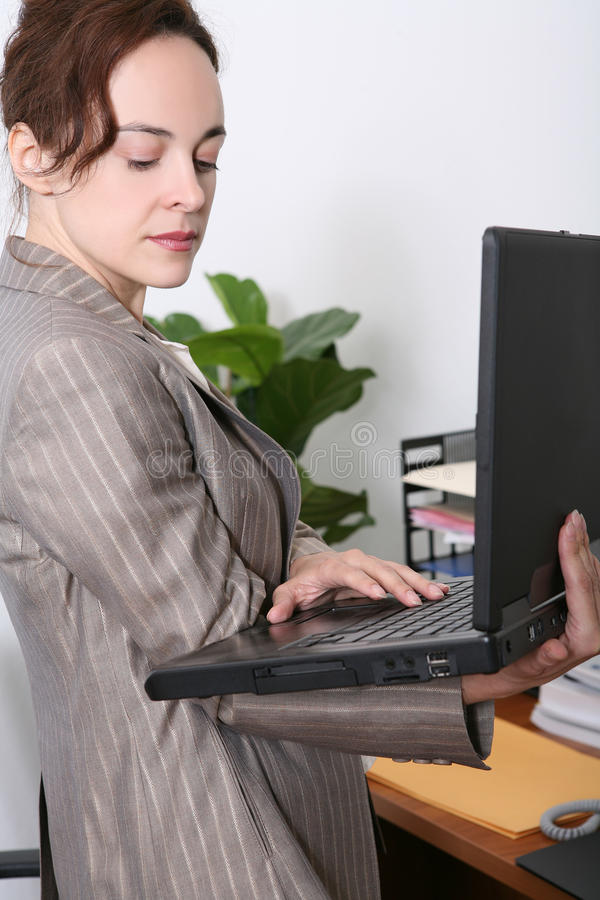 Bedrijfs Vrouw in Bureau royalty-vrije stock foto