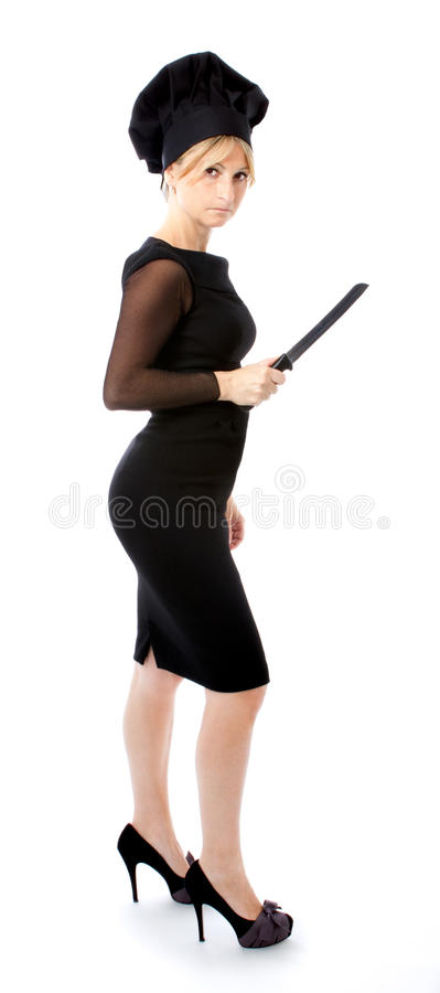 Bedrijfs vrouw in de metafoor van de chef-kokkok stock foto