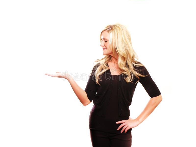 Bedrijfs vrouw die iets toont royalty-vrije stock afbeelding