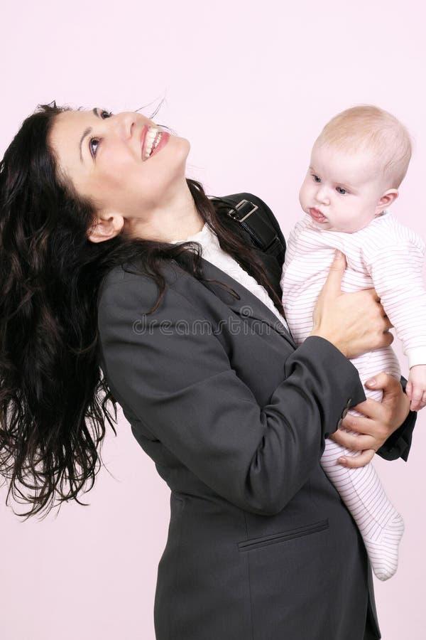 Bedrijfs vrouw en baby