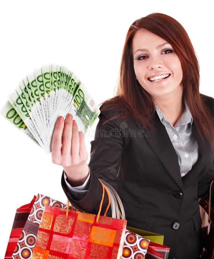 Bedrijfs vrouw met geld en het winkelen zak. stock afbeelding