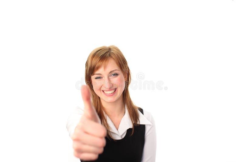 Bedrijfs vrouw met haar omhoog duim stock foto