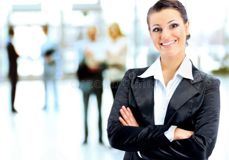 Bedrijfs vrouw met haar personeel royalty-vrije stock foto's