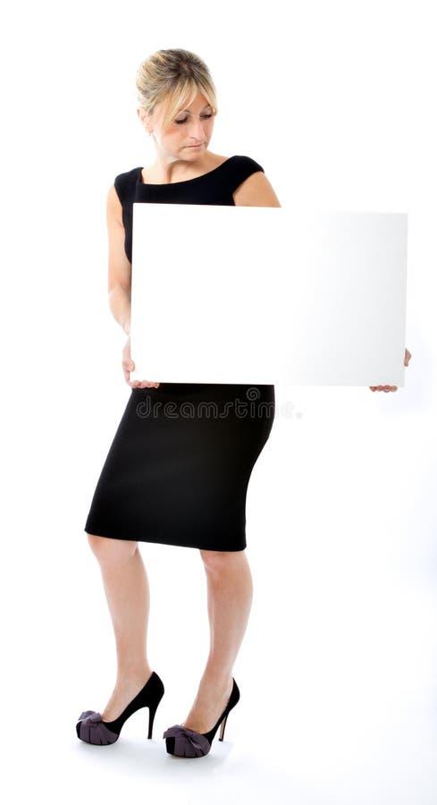 Bedrijfs vrouw met lege raad stock afbeelding