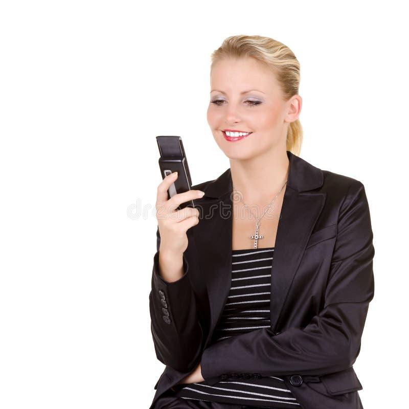 Bedrijfs vrouw met mobiele telefoon stock foto