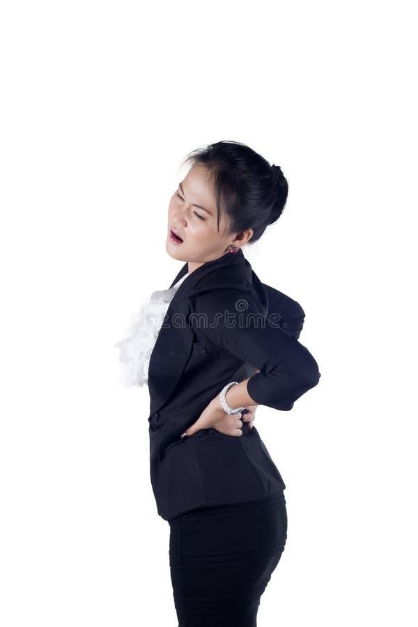 Bedrijfs vrouw met rugpijn stock foto's