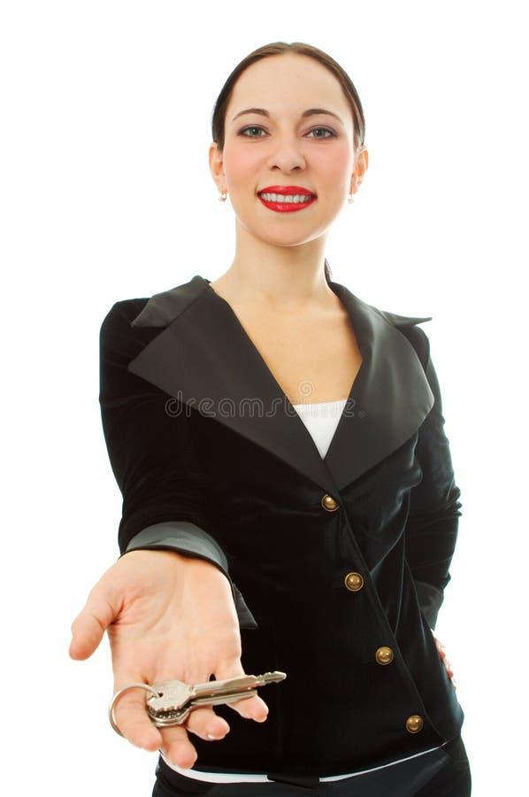 Bedrijfs vrouw met sleutels stock afbeelding