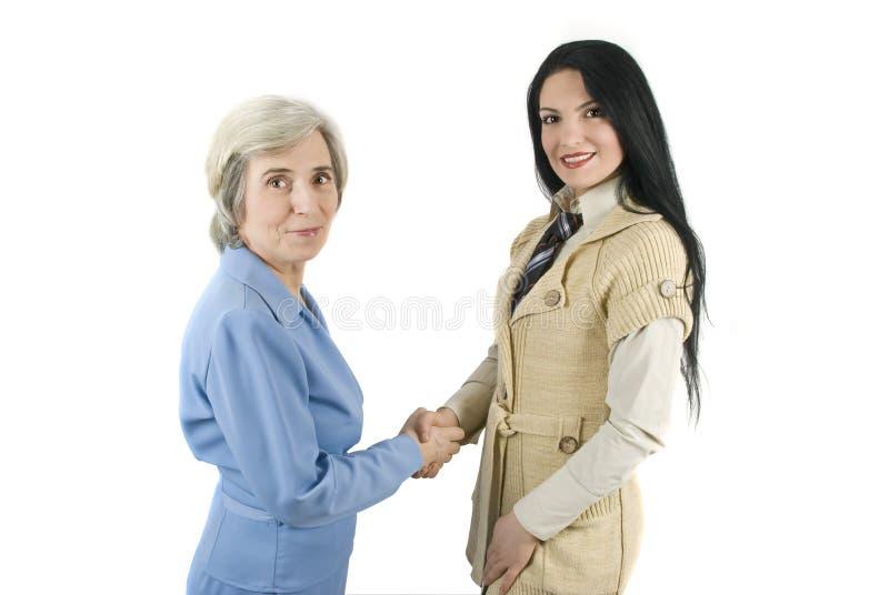 Bedrijfs vrouwenhanddruk stock foto