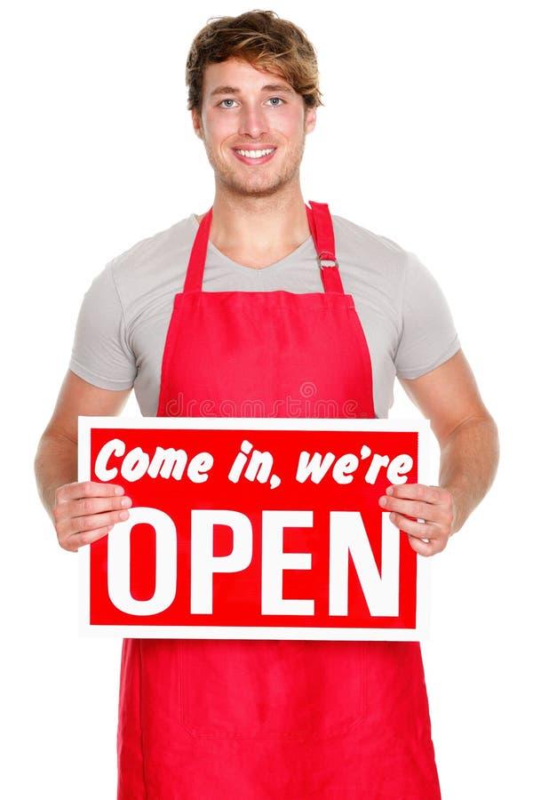 Bedrijfs winkeleigenaar die open teken toont stock fotografie