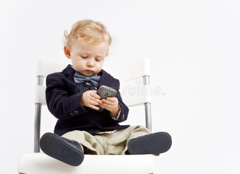 Bedrijfsbaby met telefoon royalty-vrije stock fotografie