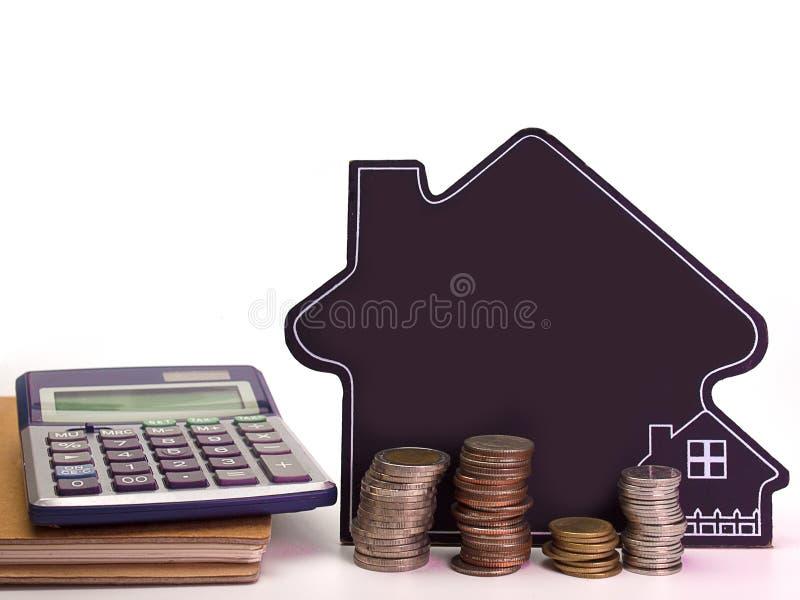 Bedrijfsconcept, geldmuntstukken met huis, stock afbeelding