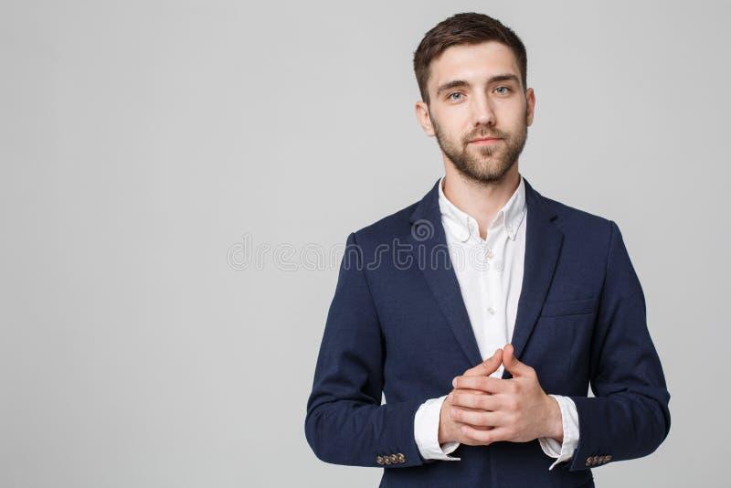 Bedrijfsconcept - hand Portret de Knappe van de Bedrijfsmensenholding met zeker gezicht Witte achtergrond De ruimte van het exemp royalty-vrije stock fotografie