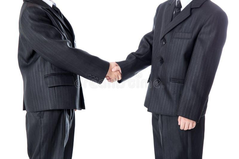 Bedrijfsconcept - handdruk van twee kleine jongens in pak royalty-vrije stock afbeeldingen