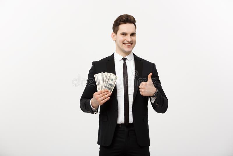 Bedrijfsconcept - Succesvolle die de dollarrekeningen van de Zakenmanholding en het tonen van duim omhoog over witte achtergrond  royalty-vrije stock foto's