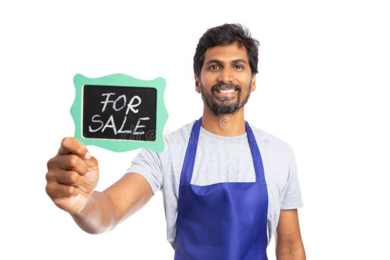 Bedrijfseigenaar of opslagmanager die zijn bedrijf verkopen royalty-vrije stock afbeeldingen